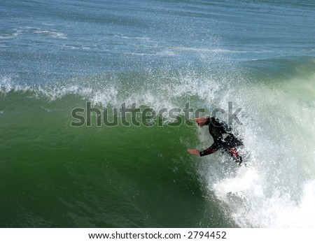 Surfer Gets Barrelled in Southern California Surf - stock photo