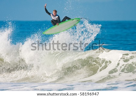 Surfer gets Big Air - stock photo