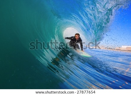 Surfer Gets Epic Tube, View from Inside the Wave - stock photo