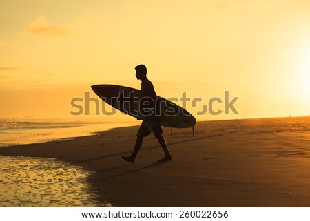 surfer heading to the sea