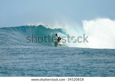 Surfer in barrel getting tube view, Mentawai Islands, Indonesia - stock photo