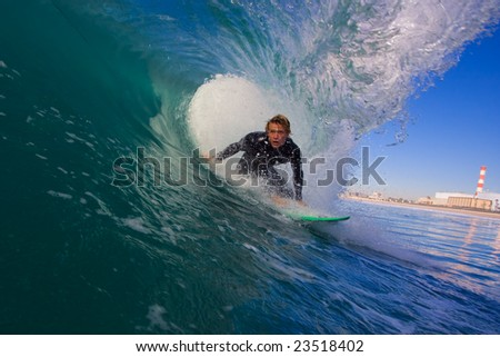Surfer in Blue Tube - stock photo