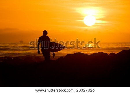 Surfer in Sunset - stock photo