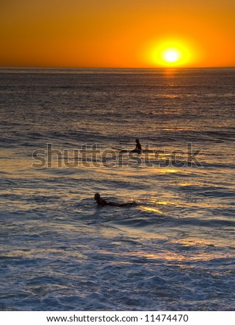 Surfer in Sunset in Windansea, La Jolla, California