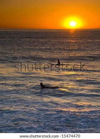 Surfer in Sunset in Windansea, La Jolla, California - stock photo