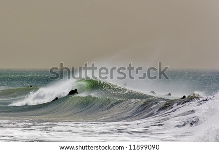Surfer in the Barrel on a classic California Winter wave - stock photo