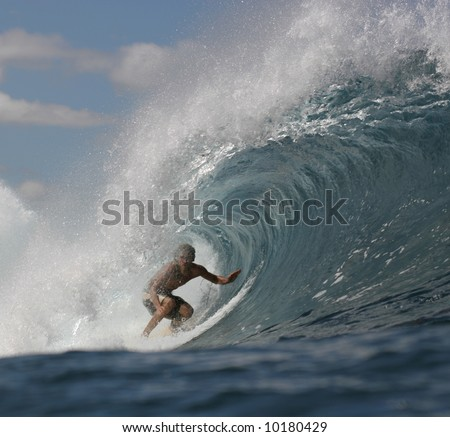 surfer in the tube - stock photo