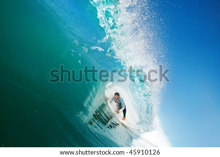 Surfer in the Tube, Big Ocean Wave - stock photo