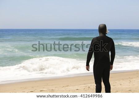 Surfer looking for waves - stock photo