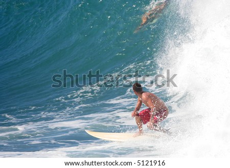 Surfer looking up at a giant wave on the coast of Maui, Hawaii. - stock photo