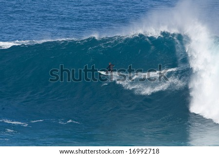 Surfer on a giant wave at Jaws Maui Hawaii a legendary big wave riding location March 2005 - stock photo