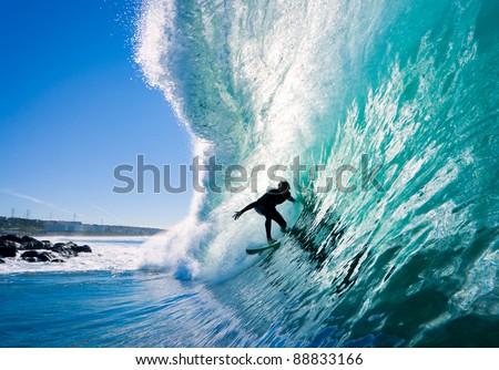 Surfer on Amazing Blue Wave - stock photo