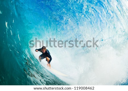 Surfer on Blue Ocean Wave in the Tube Getting Barreled - stock photo