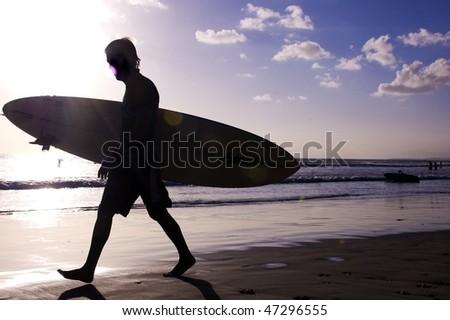 Surfer on the beach - stock photo