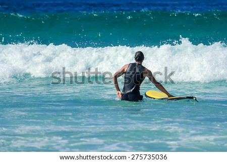 Surfer On The Beach In Summer - stock photo