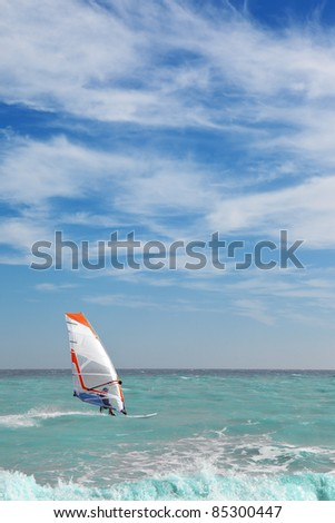 Surfer on the sea - stock photo