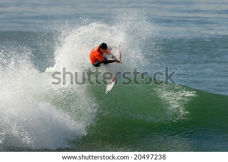 Surfer on wave - stock photo