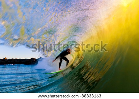 Surfer on Wave at Sunset, Getting Barreled in the Tube - stock photo