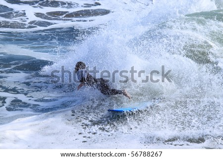 Surfer riding a wave in the Pacific Ocean