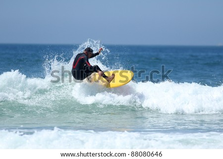 surfer riding the wave - stock photo