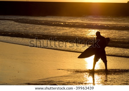 surfer silhouette at the sunset - stock photo