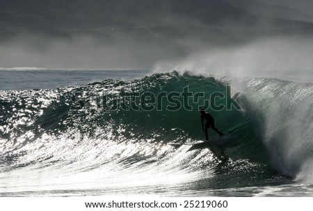 surfer taking a barrel in Salsipuedes beach, mexico - stock photo