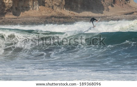 surfer while rides a wave - stock photo