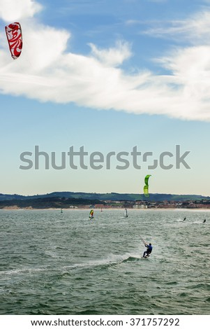 Surfer with kite surfing off the beach.Surfer with kite surfing off the beach - stock photo