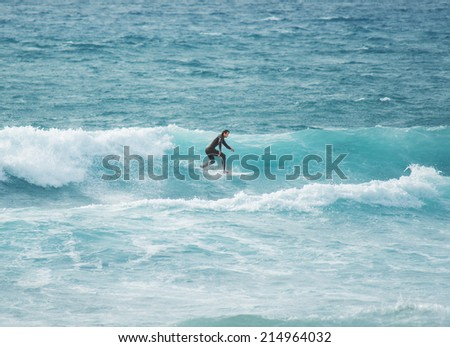 surfer with shortboard in Sardinia