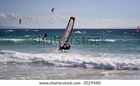 surfers in action - stock photo