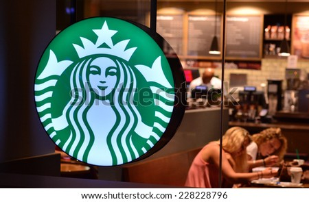SURFERS PARADISE - OCT 28 2014:Starbucks Cafe.The company planned to open 900 new stores outside of the United States in 2009 but has announced 300 store closures in the United States since 2008. - stock photo