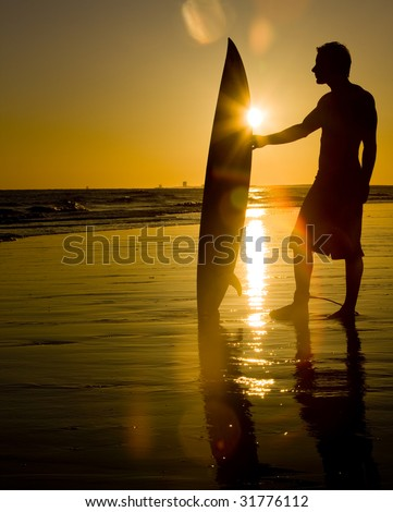 Surfing at Sunset - stock photo