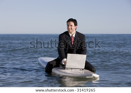 Surfing Businessman - stock photo