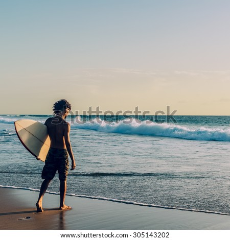 Surfing. Freedom. Emotions. Life. Surfer going to surf - stock photo