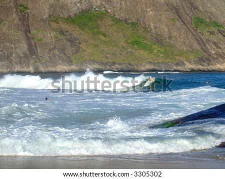 Surfing in Itacoatiara beach, Niterói, Rio de Janeiro, Brazil - stock photo