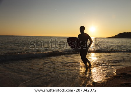 Surfing in San Pol de Mar in the coast of Catalonia, Spain - stock photo