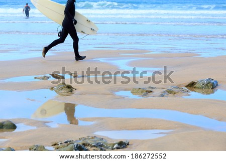 Surfing on Fistral Beach, Newquay - stock photo