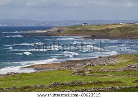Surfing on irish beach in Fanore - stock photo