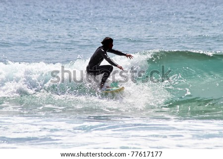 Surfing the waves - stock photo