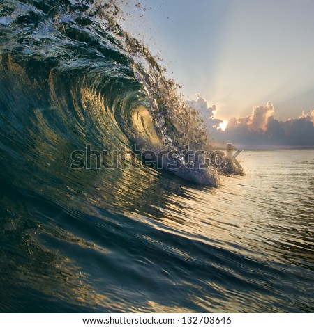 Surfing tropical design template. Breaking curled shorebreak wave with beautiful sunset - stock photo