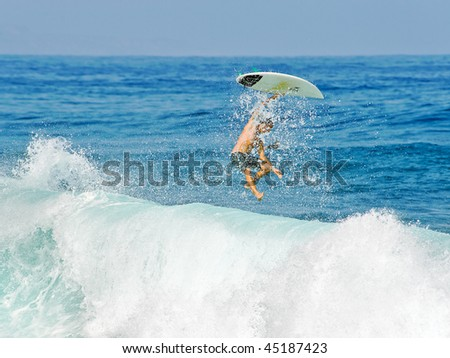 Surfing Wipeout - stock photo
