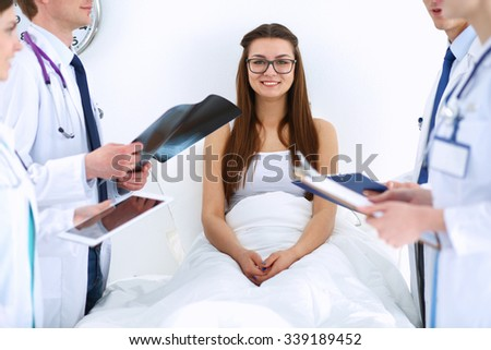 Surgeon and doctor analyzing x-ray together in medical office - stock photo