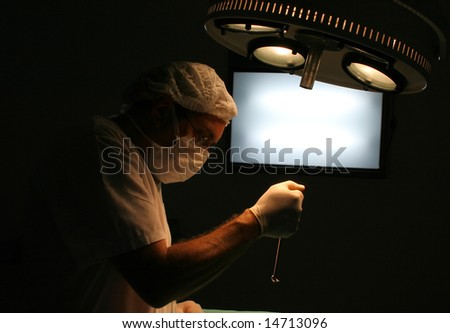 Surgeon at the operation room - stock photo