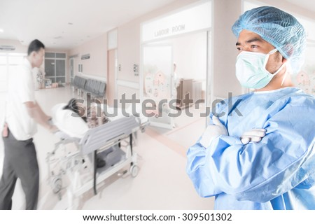Surgeon cross arm action and medical active staff pushing stretcher gurney bed in labour room of hospital corridor with female patient pregnant in emergency status  - stock photo