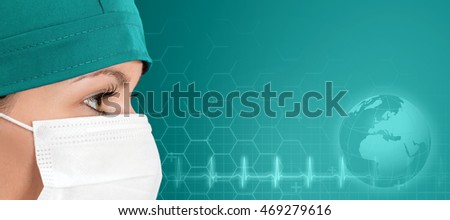 Surgeon doctor in mask with green background