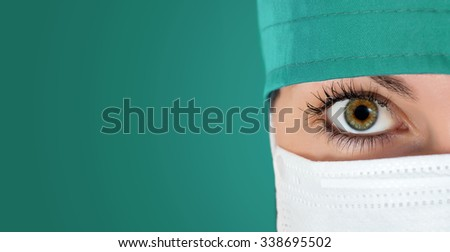 Surgeon gazing hospital close up shot with green background - stock photo