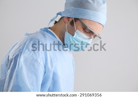 Surgeon getting ready to operate - stock photo