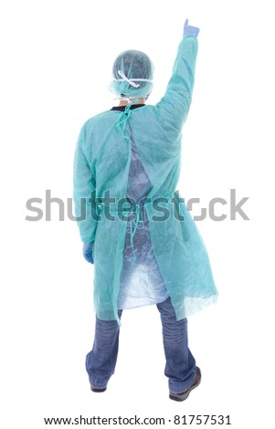 Surgeon in mask and gloves - stock photo