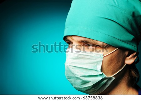Surgeon in mask close-up portrait - stock photo