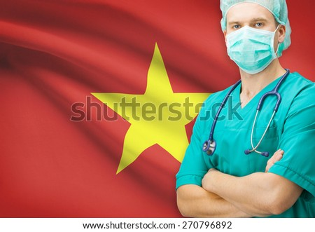 Surgeon with national flag on background - Vietnam - stock photo